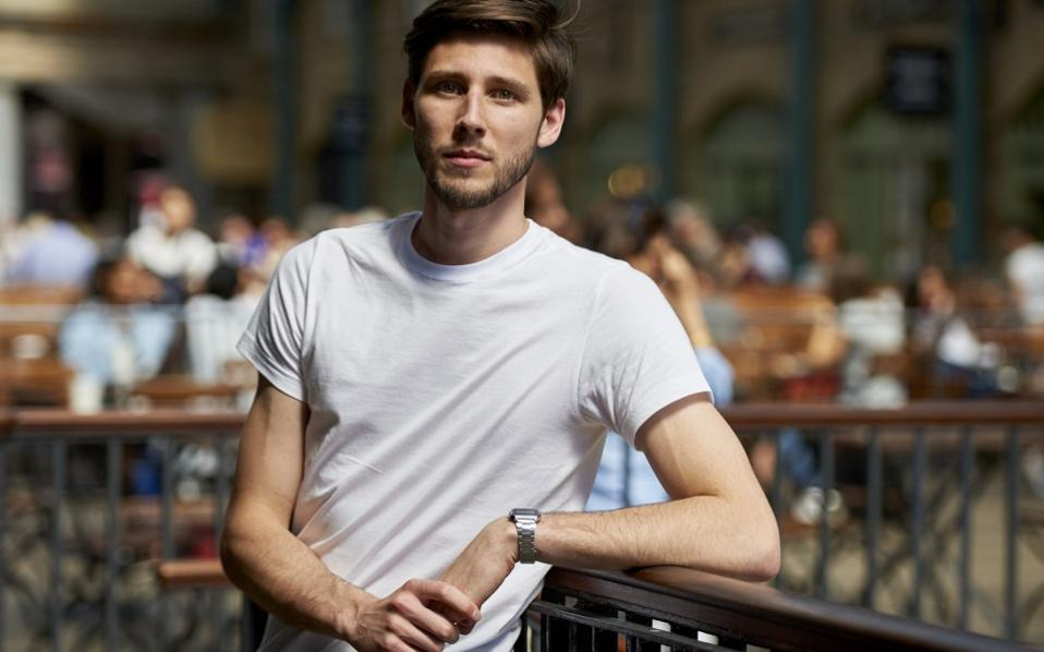 Britain's Thom Feeney poses in central London on June 30. Feeney, a shoe-shop employee has raised over 65,000 euros ($72,000) so far through an online crowdfunding project to help Greece meet its International Monetary Fund debt repayment.