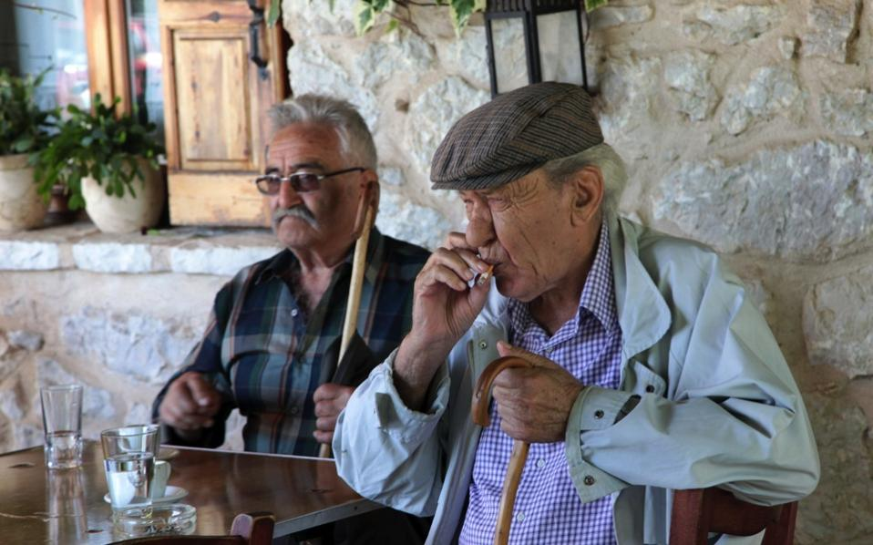 Pensioner Panayiotis Theodoropoulos smokes a cigarette at a cafe in the village of Karitaina about 210km (131 miles) southwest of Athens.