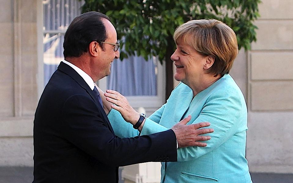 France's President Francois Hollande, left, welcomes German chancellor Angela Merkel prior to a meeting, at the Elysee Palace, in Paris, on Monday
