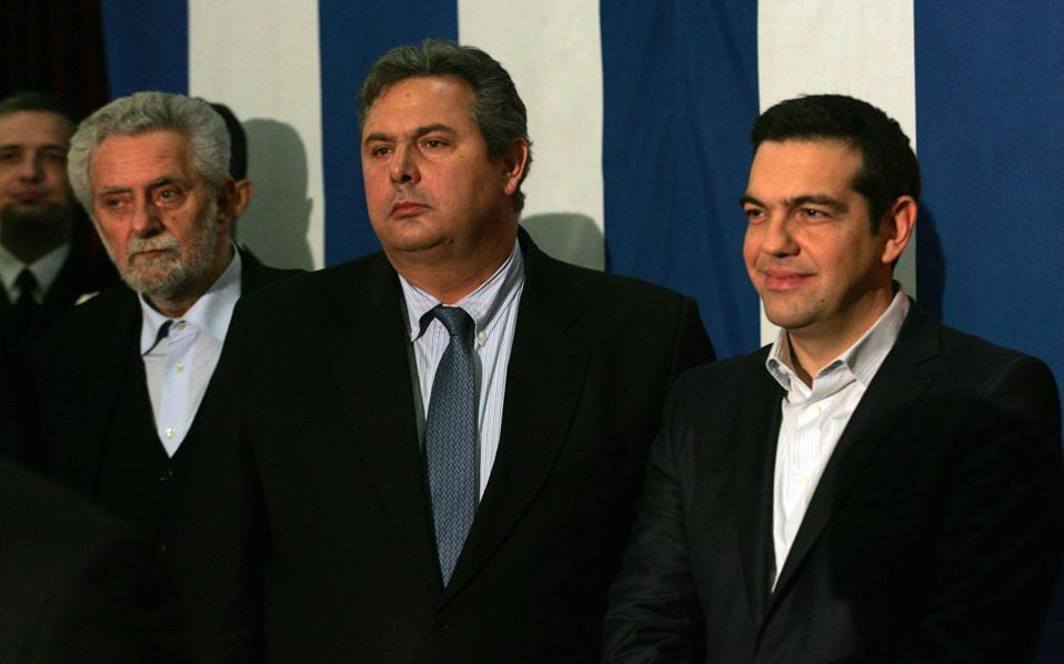 Junior coalition partner Panos Kammenos, center, and Prime Minister Alexis Tsipras in a file photo.