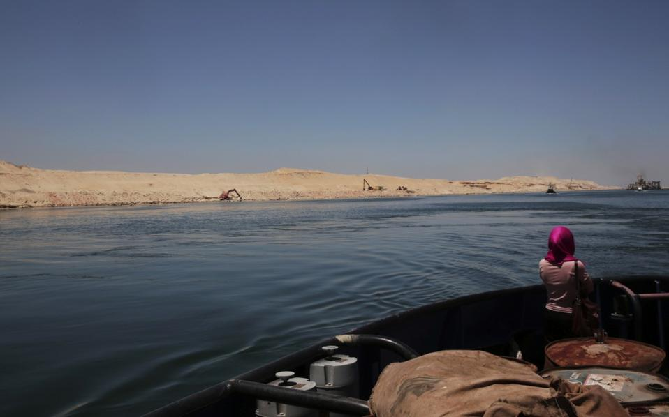 A woman looks at a new section of the Suez Canal during a media tour in Ismailia, Egypt, last week.