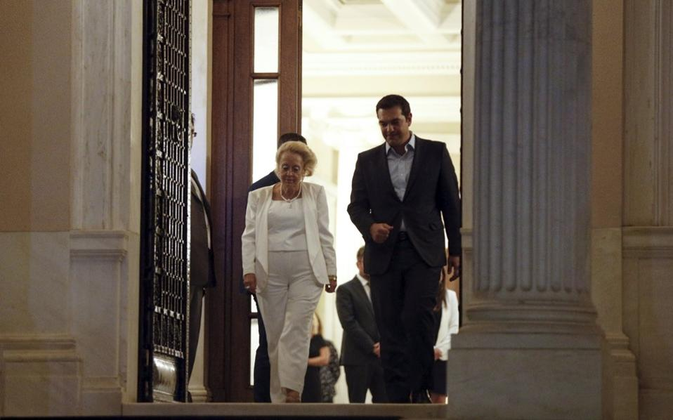 Greece's caretaker prime minister Vassiliki Thanou (l) escorts outgoing Prime Minister Alexis Tsipras following a handover ceremony at the prime minister's office at Maximos Mansion in Athens, on Thursday.
