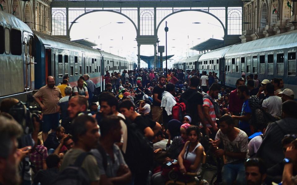 Migrants and refugees crowd the platforms at the Keleti (eastern) railway station in Budapest on Tuesday.
