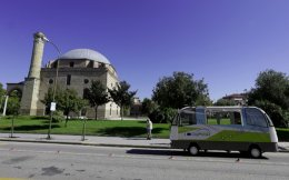 The tiny CityMobil2 driverless bus takes its route in front of Osman Sah Mosque, in Trikala town, Greece.