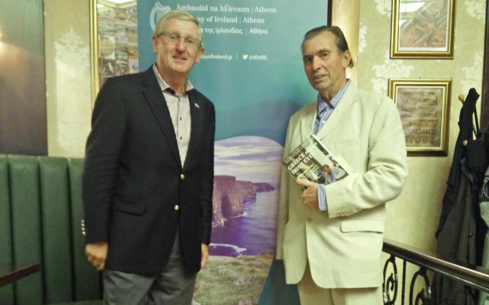 Irish Ambassador Noel Kilkenny (left) and author Richard Pine (right) pose at the launch of the latter's new book at the James Joyce pub in Athens on Wednesday.