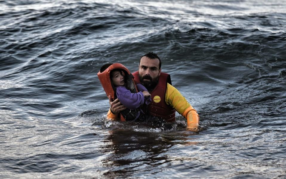 refugee_father_waves