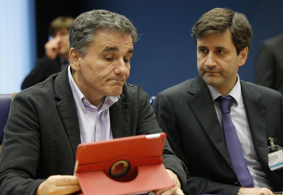 Greek Finance Minister Euclid Tsakalotos (left) and Alternate Minister of Finance Giorgios Houliarakis (right) at the Eurogroup finance ministers meeting at the European Convention Center in Luxembourg on Monday.