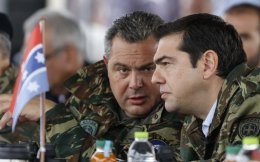 Prime Minister Alexis Tsipras (R) and Defense Minister Panos Kammenos are seen deep in discussion at the Parmeneion military exercises in Evros, northeastern Greece, Friday. During their visit, Tsipras pledged that his government would seek to restore wages in the military to 2012 levels, as per a court ruling in 2013.