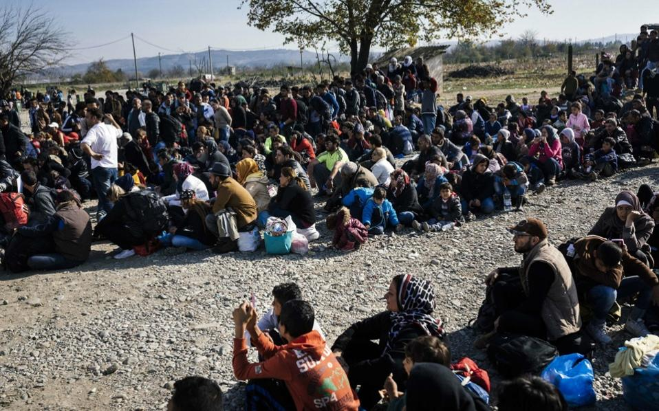 Migrants and refugees wait to enter a registration camp near Gevgelija after crossing the border from Greece into the Former Yugoslav Republic of Macedonia, on Wednesday.