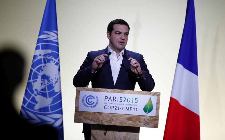 Prime Minister Alexis Tsipras delivers his statement at the COP21, United Nations Climate Change Conference, outside Paris, Monday. Addressing the participants, Tsipras attacked 'neoliberal capitalist globalization,' saying that participating nations have an obligation toward future generations to act on climate change. 'This meeting must become a historic turning point. We must step up global transition toward an eco-friendly, sustainable society,' he said.