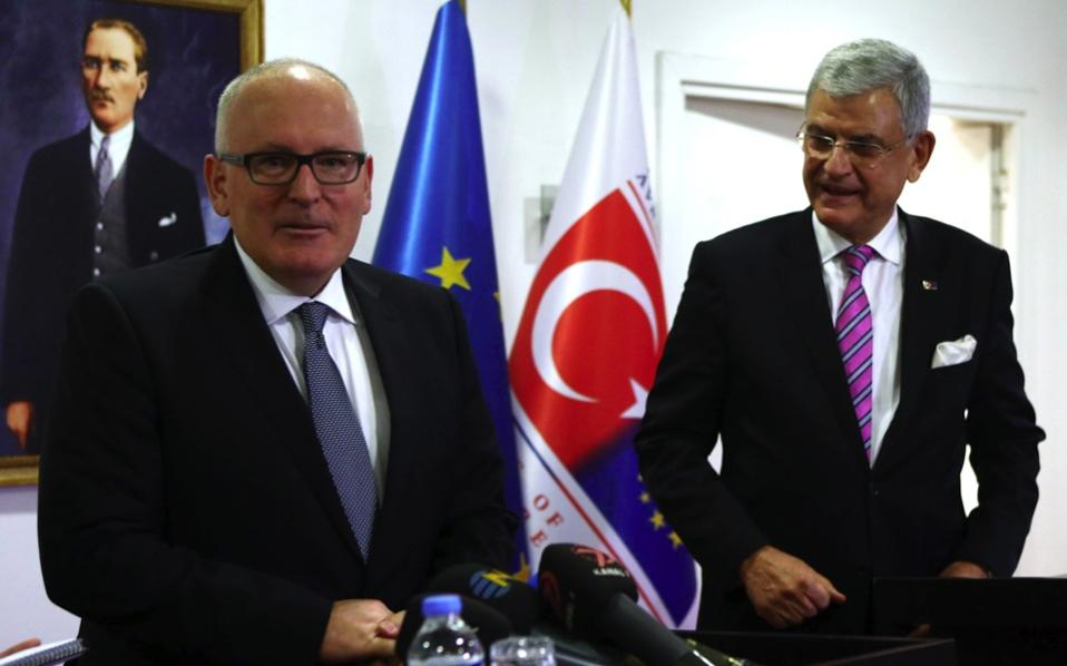 Frans Timmermans, left, and Volkan Bozkir in Ankara on Monday.