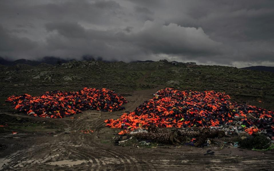 Piles of life jackets used by refugees and migrants to cross the Aegean sea from the Turkish coast remain stacked on the northeastern Greek island of Lesvos, on Thursday.