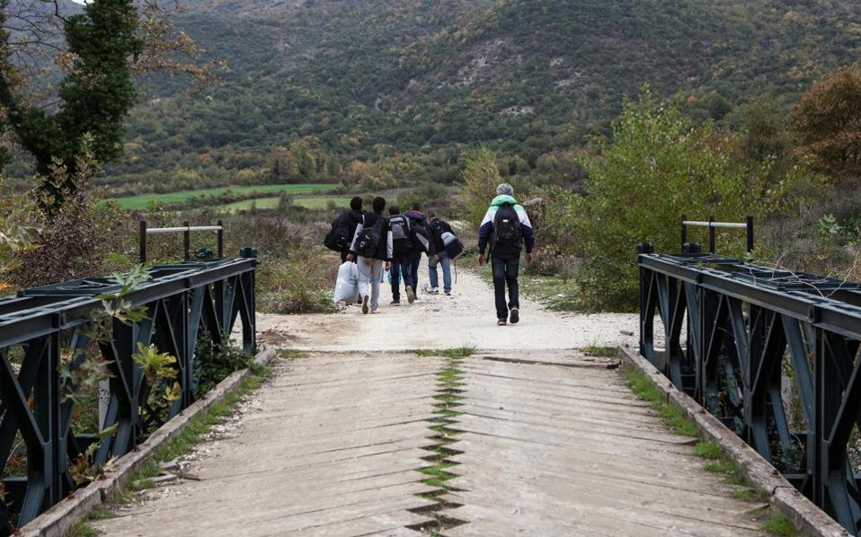 Syrian refugees cross a bridge in Gjirokaster, Albania, near the Kakavia border crossing from Greece, in a 2014 photograph.