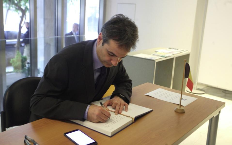 Kyriakos Mitsotakis signing the book of condolences at the Belgian Embassy in Athens on Wednesday.