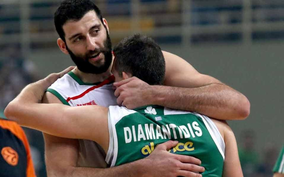 Laboral's Yiannis Bourousis hugs his former Greece teammate, Dimitris Diamantidis of Panathinaikos who has played his last Euroleague game.