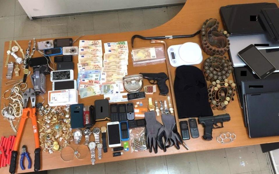A police handout photo shows items seized during raids on several properties linked to the suspects.