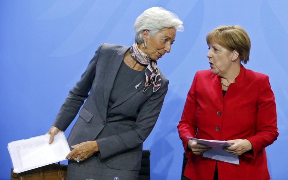 Christine Lagarde, Managing Director of the International Monetary Fund (IMF), and German Chancellor Angela Merkel attend a news conference following a meeting of the heads of international economy and finance organizations at the Chancellery in Berlin, on Tuesday.