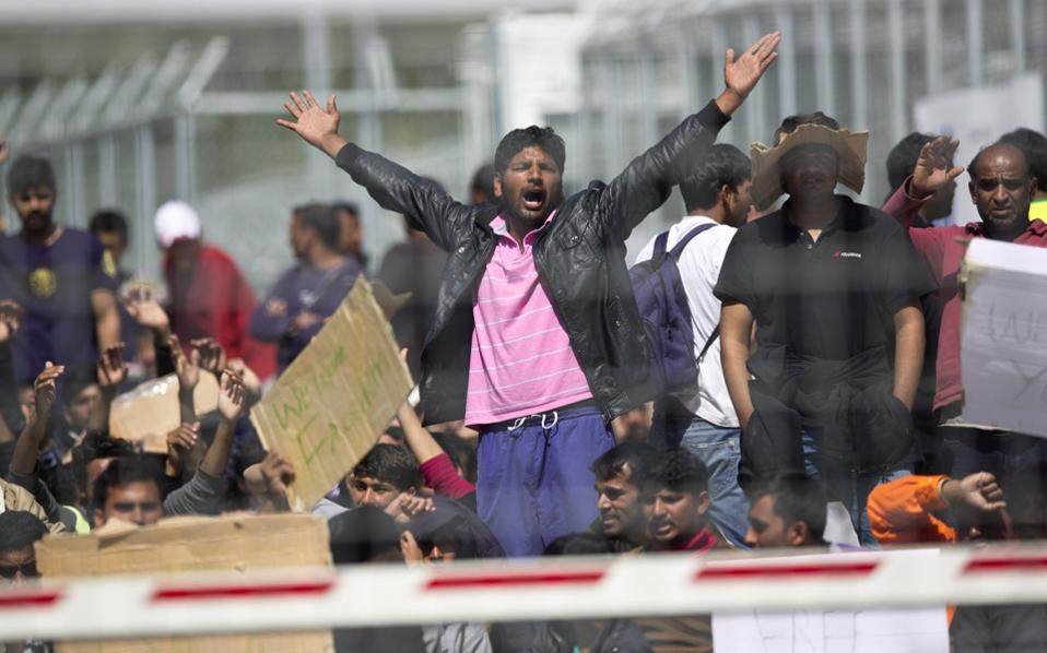 Migrants, most of them from Pakistan, protest against the EU-Turkey deal about migration at Moria camp in the Greek island of Lesvos on Tuesday.