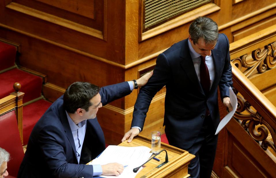 tsipras_touching_mitstoakis