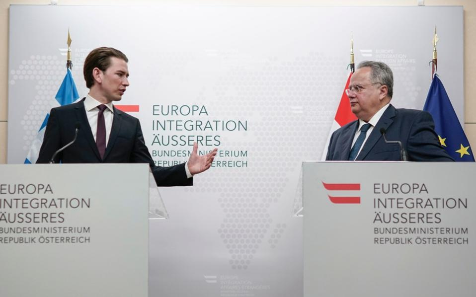 Foreign minister of Greece Nikos Kotzias (R) and his Austrian counterpart Sebastian Kurz give a press conference in Vienna, on Wednesday.