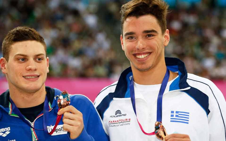 Christou (right) sports his bronze medal in London, next to Italy's Sabbioni.