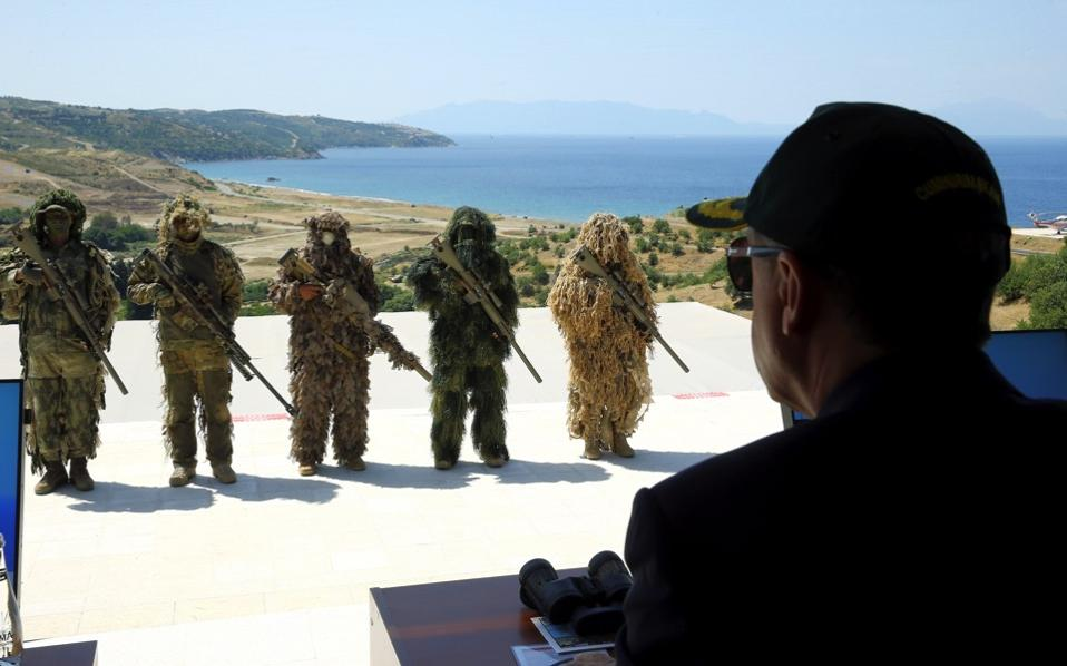 Turkish army's special force members in camouflage perform as Turkey's President Recep Tayyip Erdogan observes EFES 2016, Turkey's largest military exercise with multifaceted operations, including air and amphibious assaults, in Seferihisar near Izmir, Turkey, Tuesday.