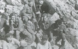 General Heinrich Kreipe (center) is seen with his head bowed on Mount Psiloritis during his abduction. Patrick Leigh Fermor is seen at his right. Exhaustion is written all over the men's faces.