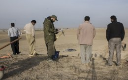 Orfeas-Konstantinos Sotiriou (center) is seen in a file photo from a dig with Athens University in northern Iraq.