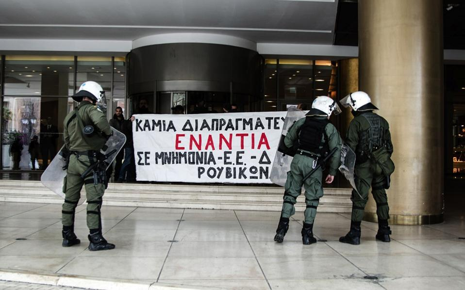 Members of Rouvikonas hold up a banner protesting ongoing negotiations with creditors outside the Athens hotel where the creditors' representatives are based, last month.