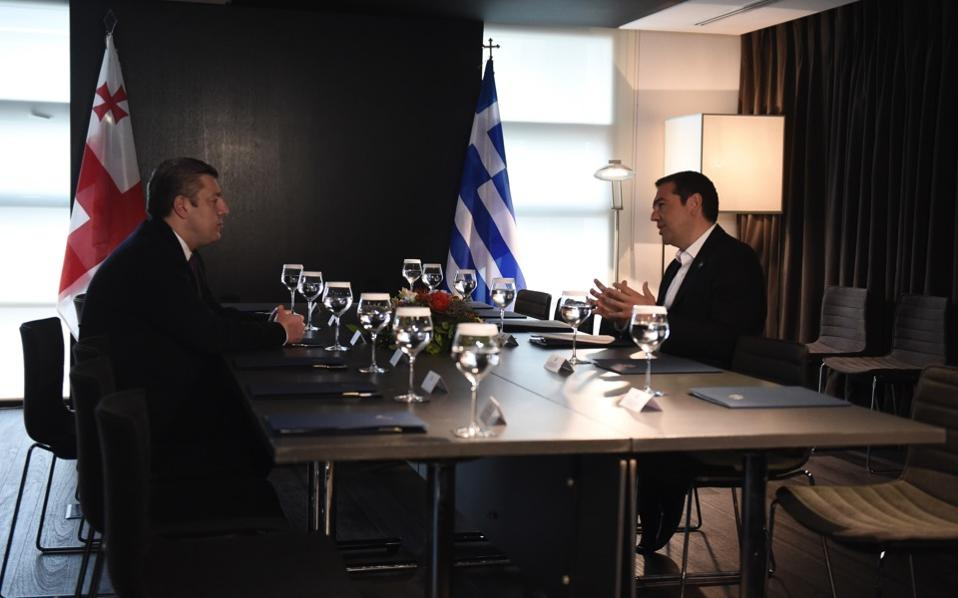 Greece's Prime Minister Alexis Tsipras (r) speaks with his Georgian Giorgi Kvirikashvili during their meeting in the northern Greek city of Thessaloniki, Tuesday. Tsipras and Kvirikashvili with other officials from Turkey, Bulgaria, Azerbaijan and Italy participated in a ceremony of launch of the construction of Trans Adriatic Pipeline (TAP).