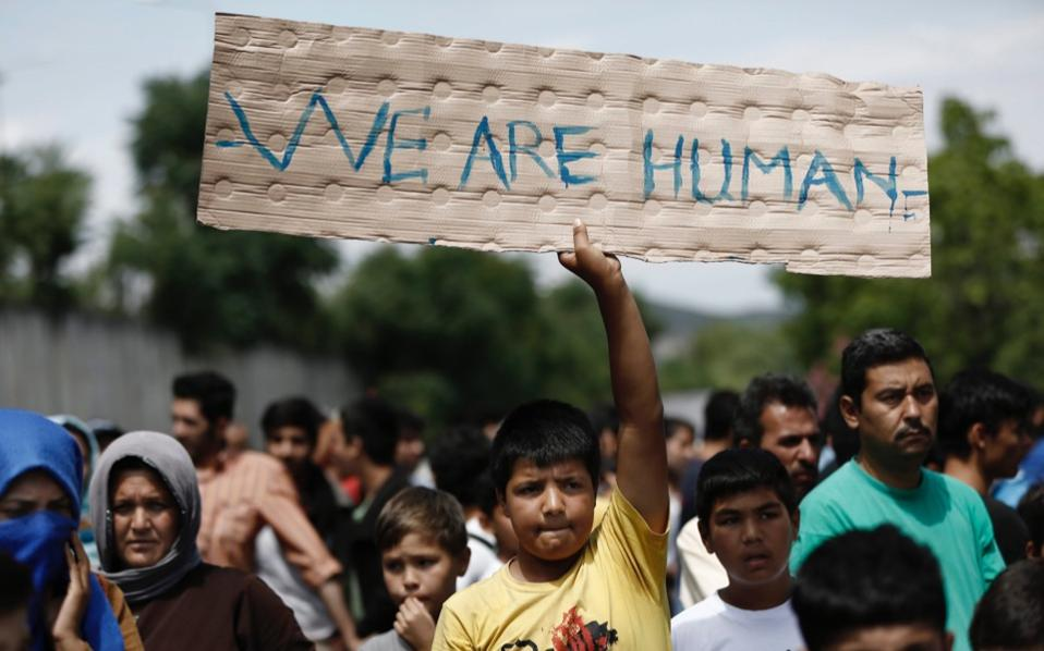 Afghan migrants take part in a protest demanding better living conditions at a reception center near Malakasa, north of Athens, on Wednesday.