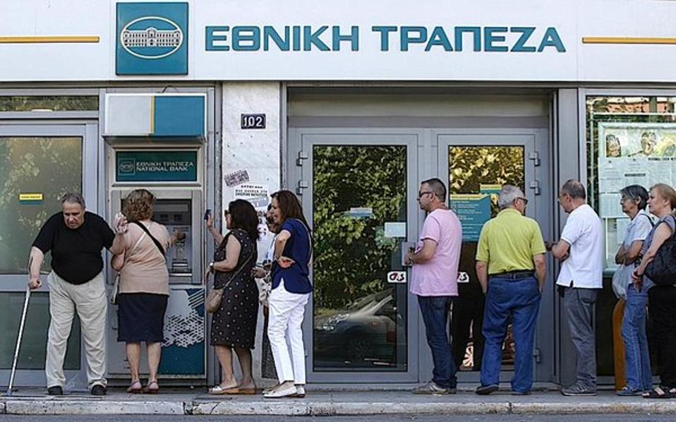 Greece marks a year of banking restrictions | Business | ekathimerini.com