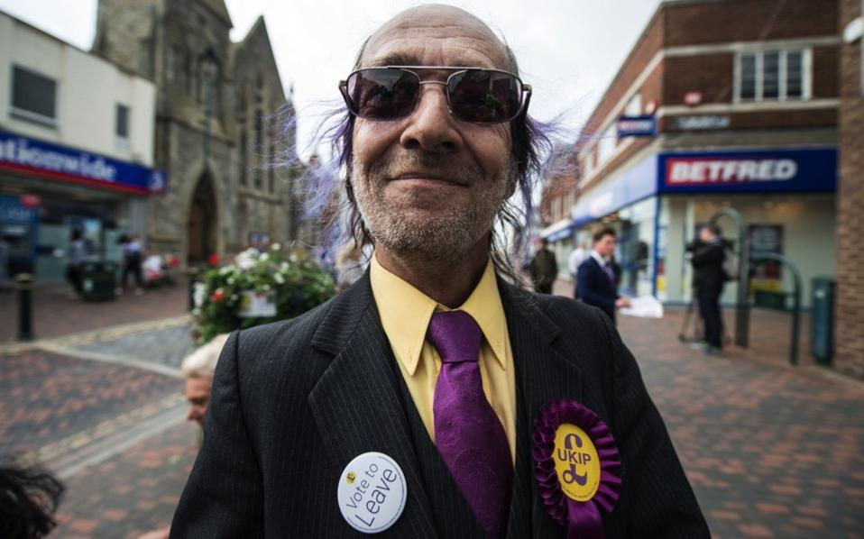UK Independence Party supporter poses in Sittingbourne as leader Nigel Farage campaigns for Brexit on Monday.