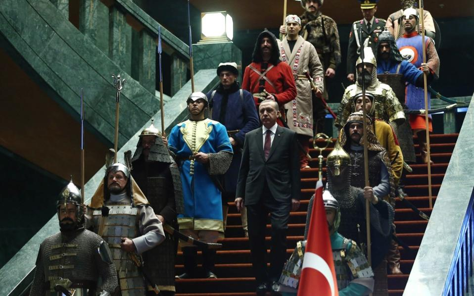 Turkish President, Recep Tayyip Erdogan (c), walks between an honor guard dressed in traditional military dress from the era of the Ottoman Empire during the official welcoming ceremony for Palestinian President Mahmoud Abbas, Presidential Palace, Ankara, Jaunary 12.