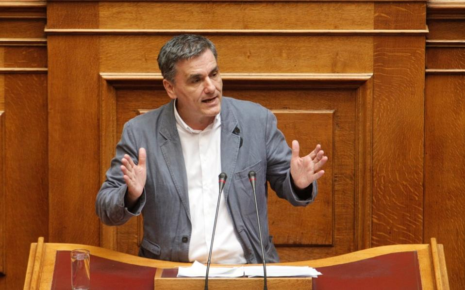 Finance minister Euclid Tsakalotos addressing the House on Thursday.