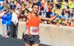 Michalis Kalomiris is seen crossing the finish line of the Athens Marathon at the Panathenaic Stadium last year.