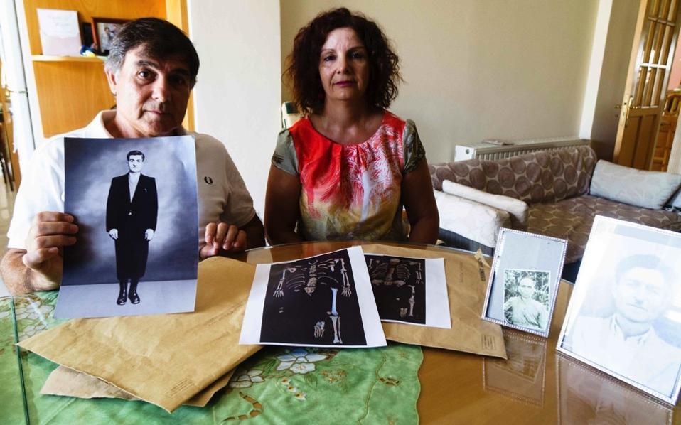 The grandson of Antonis Christofi holds the portrait of his grandfather, who went missing along with 2000 other people during the Turkish invasion of Cyprus.