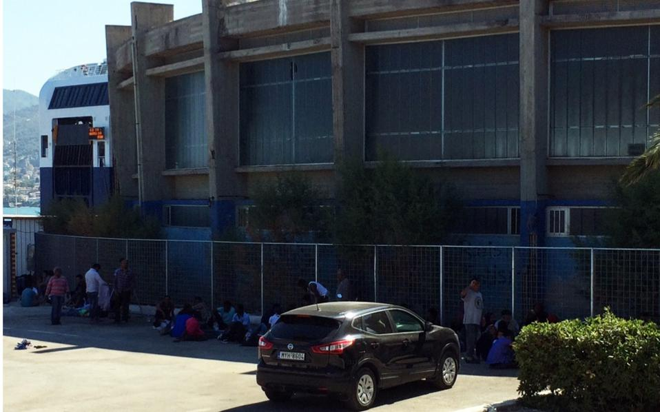 Over 120 migrants who landed on Lesvos on Monday were allowed to camp at the port after staff at the Moria hot spot said they could not take in any more arrivals.
