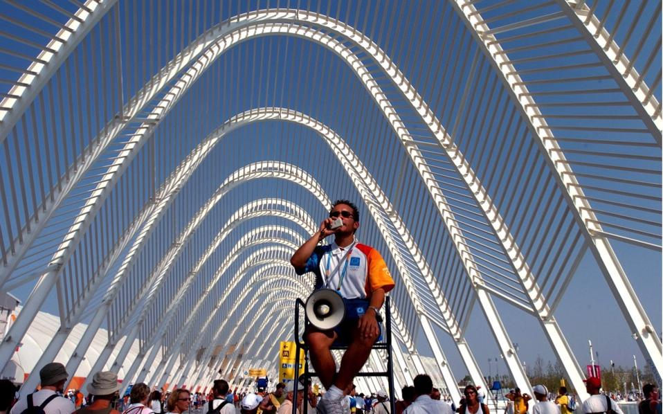 A volunteer, one of about 50,000 individuals, is seen at work during the 2004 Olympic Games in Athens.