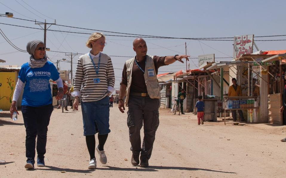 In this undated handout photo released by UNHCR on Monday, UNHCR goodwill ambassador Cate Blanchett (c) and camp manager Hovig Etyemezian (r) walk at Zaatari refugee camp as they visit Syrian refugees in Jordan. Cate Blanchett and some other big-name movie stars are speaking out about the plight of refugees in a stark, short video that entreats viewers to imagine what they would do if they had to flee war.