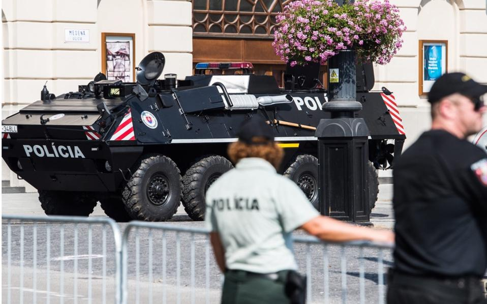 A police armored personnel carrier patrols in central Bratislava, Slovakia, as part of ramped up security measures ahead of the European Union's informal meeting of the 27 heads of state or government.