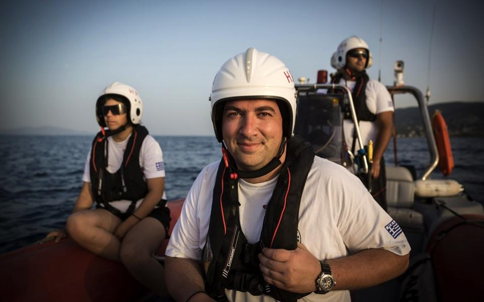 Konstantinos Mitragas, of the Hellenic Rescue Team (HRT), is seen on a boat off the Greek island of Lesvos, last month.