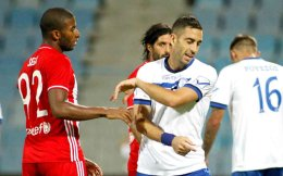 Iraklis's Lefteris Intzoglou protests about the penalty he allegedly conceded.