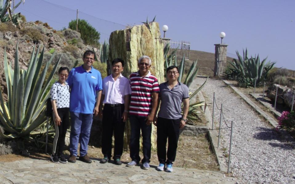 The director of the Lesvos museum, Nikos Zouros, second from left, with members of the Chinese delegations.