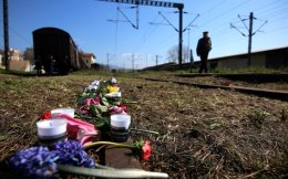 Flowers and candles are laid down at Thessaloniki's old train station, where thousands of Jews were gathered to be transported to Nazi death camps.