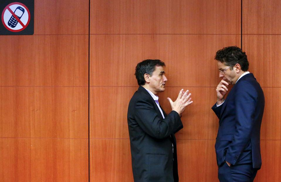Greek Finance Minister Euclkid Tsakalotos (left) with Eurogroup head Jeroen Dijsselbloem