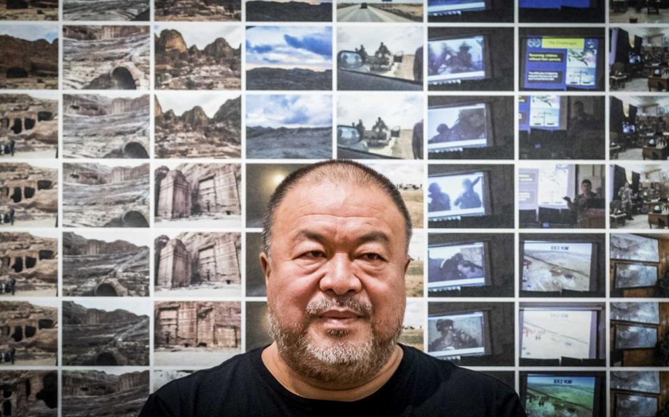 Chinese artist and activist Ai Weiwei at a press conference at the Foam photography museum in Amsterdam, on September 15, during the opening of his exhibition '#SafePassage.' The show opens to the public from September 16 and runs to December.