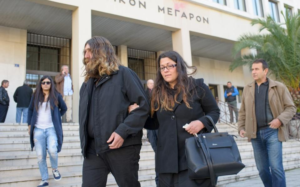 Vangelis Giakoumakis's parents are seen leaving the court on Thursday.
