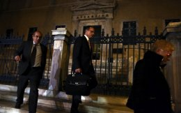 Judges leave the building of the Council of State in Athens, late Wednesday.