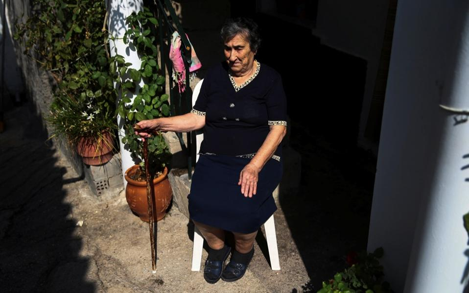 Emilia Kamvisi, 86, a Nobel Peace Prize nominee, sits at the yard of her house at the Skala Sikamias village on the island of Lesvos.